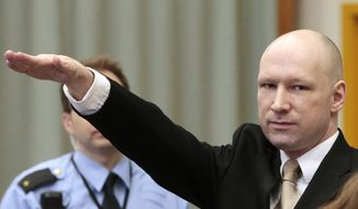 Anders Behring Breivik gestures as he enters a courtroom in Skien, Norway, on Tuesday, March 15, 2016. Breivik, the right-wing extremist who killed 77 people in bomb and gun attacks in 2011 arrived in court on Tuesday for his human rights case against the Norwegian government. (Lise Aserud, NTB scanpix via AP)  NORWAY OUT