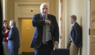 Senate Armed Services Committee Chairman John McCain, R-Ariz., leaves a closed-door GOP policy luncheon at the Capitol in Washington, Tuesday, March 15, 2016.  (AP Photo/J. Scott Applewhite)