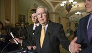 Senate Majority Leader Mitch McConnell, R-Ky., flanked by Sen. John Barrasso, R-Wyo., left, and Majority Whip John Cornyn, R-Texas, right, talks to reporters following a closed-door policy meeting at the Capitol in Washington, Tuesday, March 15, 2016. (AP Photo/J. Scott Applewhite) ** FILE **