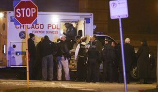 Members of the Chicago Police Department investigate the scene of a police involved shooting in the 3700 block of West Polk Street in the Homan Square neighborhood in Chicago on Monday, March 14, 2016. Three officers were shot and one suspect was killed at the scene. The officers were rushed to Stroger Hospital for treatment of injuries that are not life-threatening, according to police spokesman Anthony Guglielmi. (Nuccio DiNuzzo/Chicago Tribune via AP) MANDATORY CREDIT, CHICAGO SUN-TIMES OUT, DAILY HERALD OUT, NORTHWEST HERALD OUT, DAILY CHRONICLE OUT, THE HERALD-NEWS OUT, THE TIMES OF NORTHWEST INDIANA OUT, TV OUT, MAGS OUT, NO SALES