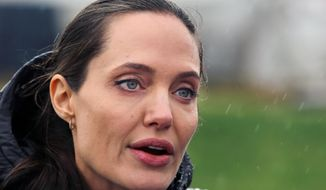 U.S. actress Angelina Jolie, Special Envoy of the United Nations High Commissioner for Refugees, speaks during a press conference at a Syrian refugee camp, in the eastern city of Zahleh, Lebanon, Tuesday, March 15, 2016. (AP Photo/Bilal Hussein)