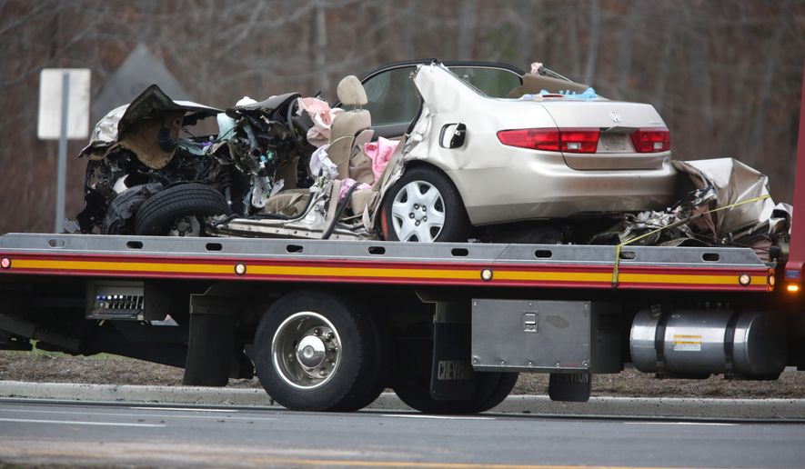 A Vehicle Is Towed Away After A Fatal Accident On Route 9