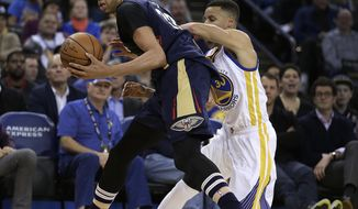 New Orleans Pelicans' Anthony Davis, left, looks to pass away from Golden State Warriors' Stephen Curry during the second half of an NBA basketball game, Monday, March 14, 2016, in Oakland, Calif. (AP Photo/Ben Margot)