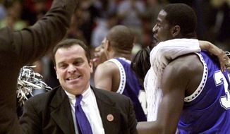 Hampton coach Steve Merfeld runs around the court as players celebrate following a 58-57 win over Iowa State in an NCAA West regional first-round game Thursday, March 15, 2001, in Boise, Idaho. (AP Photo/Jack Smith)