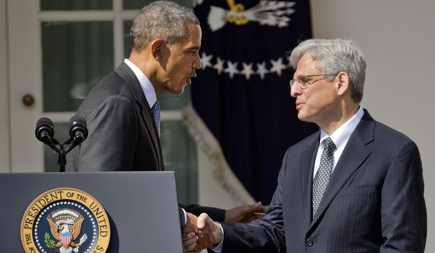 Federal appeals court judge Merrick Garland shakes hands with President Obama as he is introduced as Obama's nominee for the Supreme Court on Wednesday in the Rose Garden of the White House. (Associated Press)
