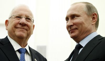 Russian President Vladimir Putin, right, and Israeli President Reuven Rivlin meet in the Kremlin in Moscow, Russia, Wednesday, March 16, 2016. Israeli President Reuven Rivlin is on official visit in Moscow. (Maxim Shipenkov/Pool Photo via AP)