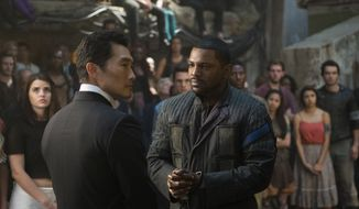 "This image released by Lionsgate shows Daniel Dae Kim, left, and Mekhi Phifer in a scene from ""The Divergent Series: Allegiant."" (Murray Close/Lionsgate via AP)"