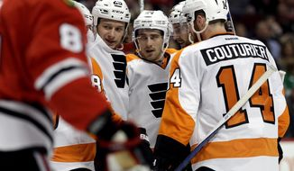 Philadelphia Flyers defenseman Andrew MacDonald (47), second from right, celebrates with teammates after scoring his goal against the Chicago Blackhawks during the first period of an NHL hockey game Wednesday, March 16, 2016, in Chicago. (AP Photo/Nam Y. Huh)