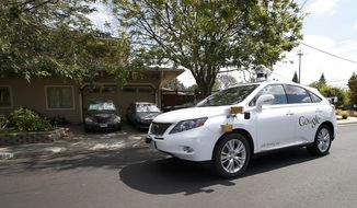 FILE - In this Wednesday, May 13, 2015, file photo, Google's self-driving Lexus car drives along street during a demonstration at Google campus on  in Mountain View, Calif. As Google cars encounter more and more of the obstacles and conditions that befuddle human drivers, the autonomous vehicles are likely to cause more accidents, such as a recent low-speed collision with a bus. (AP Photo/Tony Avelar, File)