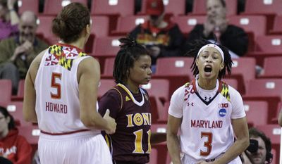 Maryland guard Brene Moseley, right, and Malina Howard react in front of Iona guard Philecia Gilmore after Moseley was fouled while shooting a basket in the first half of an NCAA college basketball game in the first round of the NCAA Tournament, Saturday, March 19, 2016, in College Park, Md. (AP Photo/Patrick Semansky)