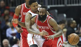 Houston Rockets guard James Harden (13) has the ball knocked out of his hands by Atlanta Hawks forward Kent Bazemore (24) in the first half of an NBA basketball game  Saturday, March 19, 2016, in Atlanta. (AP Photo/John Bazemore)