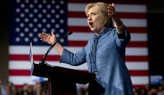 FILE - In this March 15, 2016, file photo, Democratic presidential candidate Hillary Clinton speaks during an election night event at the Palm Beach County Convention Center in West Palm Beach, Fla. Clinton spent much of a 72-hour time frame last week cleaning up misstatements about former first lady Nancy Reagan's role in addressing the AIDS epidemic, whether her policies would kill coal mining jobs and her 1993 health care plan. (AP Photo/Carolyn Kaster, File)