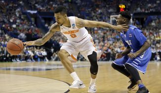 Syracuse's Michael Gbinije, left, reaches for the ball alongside Middle Tennessee's Quavius Copeland during the first half in a second-round men's college basketball game in the NCAA Tournament, Sunday, March 20, 2016, in St. Louis. (AP Photo/Jeff Roberson)