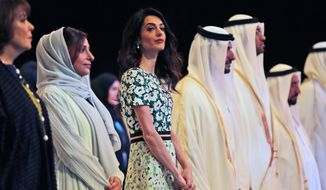 Amal Alamuddin Clooney, writer, human rights activist, 3rd left, listens to the national anthem during the opening ceremony of the International Government Communications Forum in Sharjah, United Arab Emirates, Sunday, March 20, 2016. (AP Photo/Kamran Jebreili)