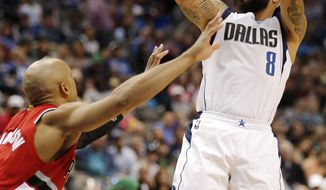 Dallas Mavericks guard Deron Williams (8) attempts a shot as Portland Trail Blazers guard Gerald Henderson (9) defends during the second half of an NBA basketball game Sunday March 20, 2016, in Dallas. (AP Photo/Brandon Wade)