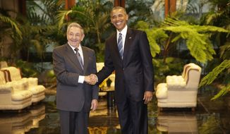 Cuban President Raul Castro, left, shakes hands with U.S. President Barack Obama during a meeting in Revolution Palace, Monday, March 21, 2016. Brushing past profound differences, President  Obama and President Castro sat down for a historic meeting, offering critical clues about whether Obama's sharp U-turn in policy will be fully reciprocated. (AP Photo/Ramon Espinosa)