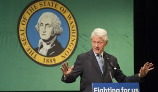 Former President Bill Clinton speaks at Clark College in Vancouver, Wash., Monday, March 21, 2016. Clinton was speaking on behalf of his wife and presidential candidate Hillary Clinton. (Natalie Behring/The Columbian via AP) MANDATORY CREDIT