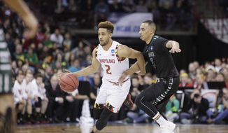 Maryland guard Melo Trimble (2) drives against Hawaii guard Quincy Smith (11) during the first half of a second-round men's college basketball game in the NCAA Tournament in Spokane, Wash., Sunday, March 20, 2016. (AP Photo/Young Kwak)