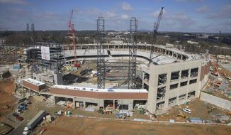 FILE - In this Wednesday, March 2, 2016, file photo,  construction continues on SunTrust Park, the future home of the Atlanta Braves baseball team, in Atlanta, Ga. A $1.4 billion retractable roof stadium under construction is a cutting-edge project that is supposed to keep big sports coming to Atlanta. Those plans could be threatened by a religious exemptions law that opponents say would clear the way for discrimination against gays, lesbians and transgender people. (Kelly J. Huff/The Marietta Daily Journal via AP, File)  ATLANTA JOURNAL CONSTITUTION OUT; MAGS OUT; NO SALES; MANDATORY CREDIT