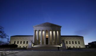 This Feb. 19, 2016 file photo shows the front of the U.S. Supreme Court building in Washington. (AP Photo/Alex Brandon, File)