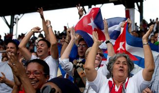 Cuban fans cheer after their national baseball team scored its first and only run in the final inning of a 4-1 exhibition loss to the Tampa Bay Rays in Havana, Cuba on Tuesday. The game was the first involving a Major League Baseball team in Cuba in 17 years. Fans mobbed for foul balls and mugged for photos throughout the game. (Associated Press Photographs)