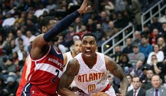 Washington guard John Wall will likely need to defend Atlanta Hawks guard Jeff Teague in two of the Wizards' final 12 games remaining. (Associated Press)