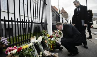 Danish Prime Minister, Lars Loekke Rasmussen, pays his respects with the Belgian Ambassador Pol De Witte at the Belgium Embassy in Copenhagen on Tuesday, March 22, 2016. Bombs exploded at the Brussels airport and one of the city's metro stations Tuesday, killing and wounding dozens of people, as a European capital was again locked down amid heightened security threats. The Islamic State group claimed responsibility for the attacks. (Philip Davali/POLFOTO via AP)  DENMARK OUT