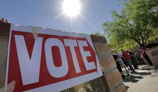 Voters wait in line to cast their ballot in Arizona's presidential primary election, Tuesday, March 22, 2016, in Gilbert, Ariz. (AP Photo/Matt York)