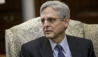 Judge Merrick Garland, President Barack Obama's choice to replace the late Justice Antonin Scalia on the Supreme Court, sits during a meeting with Sen. Robert Casey, D-Pa., on Capitol Hill in Washington, Tuesday, March 22, 2016. (AP Photo/J. Scott Applewhite) ** FILE **