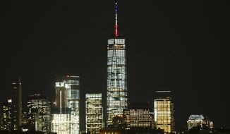 One World Trade Center is shown Tuesday, March 22, 2016, in New York. New York Gov. Andrew Cuomo has directed One World Trade Center be displayed in the Belgium colors of black, yellow and red to show solidarity with the nation following attacks that killed dozens of people in Brussels. (AP Photo/Frank Franklin II)