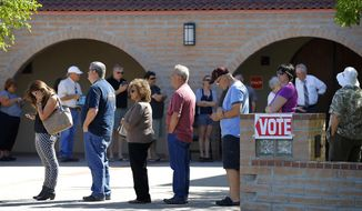 Voters wait in line to cast their ballot in Arizona's presidential primary election, Tuesday, March 22, 2016, in Gilbert, Ariz. (AP Photo/Matt York) ** FILE **