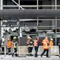 As emergency workers sorted through the damaged terminal at the Brussels airport on Wednesday, Belgian authorities were searching for a top suspect in the country's deadliest attacks in decades. (Associated Press)