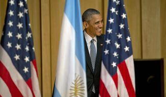 U.S. President Barack Obama arrives at a town hall meeting with young Argentines in Buenos Aires, Argentina, Wednesday, March 23, 2016. Obama is on a two day official visit to Argentina. (AP Photo/Natacha Pisarenko)