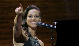 Singer Alicia Keys performs Wednesday, March 23, 2016, at the coffee company's annual shareholders meeting in Seattle. (AP Photo/Ted S. Warren) ** FILE **