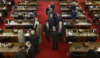 North Carolina lawmakers gather on the House floor for a special session Wednesday in Raleigh. Lawmakers voted to overturn a new Charlotte ordinance set to take effect April 1 that gives protections to transgender people to use the restroom of their gender identity. (Associated Press)
