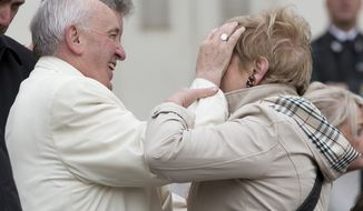 Pope Francis caresses a woman during his weekly general audience in St. Peter's Square at the Vatican, Wednesday, March 23, 2016. (AP Photo/Alessandra Tarantino)