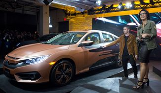 Demi Lovato and Nick Jonas unveil the 2016 Honda Civic sedan designed by Demi Lovato during a news conference, Tuesday, March 22, 2016, in New York, as part of the New York International Auto Show. (AP Photo/Mary Altaffer) **FILE**