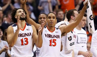 If Virginia beats Iowa State in its NCAA tournament Sweet 16 game on Friday, the senior class, led by forward Anthony Gill (13), guard Malcolm Brogdon (15) and center Mike Tobey will match the winningest class in program history with 112 victories. (Associated Press Photograph)