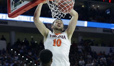 Virginia center Mike Tobey (10) dunks the ball against Butler forward Kelan Martin (30) during the first half of a second-round men's college basketball game in the NCAA Tournament, Saturday, March 19, 2016, in Raleigh, N.C. (AP Photo/Gerry Broome)