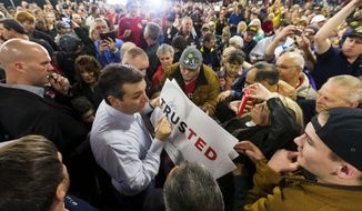 Sen. Ted Cruz in the thick of a hands-on campaign stop with voters in Idaho. (Associated Press)