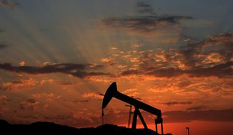 Oil producers are forecast to keep flooding the market, pulling down prices despite growing demand in the U.S. and emerging markets. (Associated Press)