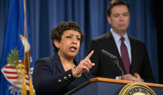 Attorney General Loretta Lynch and FBI Director James B. Comey announce the indictments of seven Iranians tied to a series of punishing cyberattacks on a small dam outside New York City and dozens of financial institutions. (Associated Press)