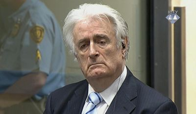 In this image taken from video Bosnian Serb wartime leader Radovan Karadzic listens to the verdict at the International Criminal Tribunal for Former Yugoslavia (ICTY) in The Hague, The Netherlands Thursday March 24, 2016. Karadzic was convicted of genocide and nine other charges Thursday at a U.N. court, and sentenced to 40 years in prison. (ICTY, Pool via AP)