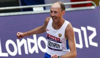 In this Saturday, Aug. 11, 2012, file photo, Sergei Kirdyapkin, of Russia, wins the gold medal in the men's 50-kilometer race walk at the 2012 Summer Olympics, in London. (AP Photo/Sergei Grits, File)