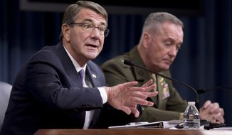 Defense Secretary Ash Carter, left, accompanied by Joint Chiefs Chairman Gen. Joseph Dunford, speaks during a news conference at the Pentagon, Friday, March 25, 2016, where he announced U.S. forces killed a senior Islamic State leader, among several key members of the militant group eliminated this week. (AP Photo/Mauel Balce Ceneta)