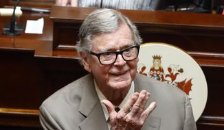"In this Wednesday, April 3, 2013, photo, author Earl Hamner Jr. blows a kiss to relatives in the gallery as he is honored by the Virginia Senate at the state capitol in Richmond, Va. On Thursday, March 24, 2016, Hamner, who created ""The Waltons"" television show, died in Los Angeles at the age of 92, according to Ray Castro Jr., a friend who produced a documentary about the writer. (AP Photo/Richmond Times-Dispatch, Bob Brown/File)"