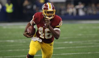 Washington Redskins running back Alfred Morris (46) runs the ball against the Dallas Cowboys during an NFL football game, Sunday, Jan. 3, 2016, in Arlington, Texas. (AP Photo/Roger Steinman)