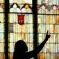 A woman sings during an Easter service at Bethel A.M.E. Church in downtown Scranton, Pa. (The Times & Tribune via Associated Press)