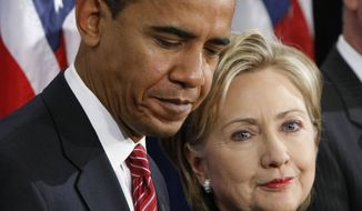President-elect Barack Obama, left, stands with Secretary of State-designate Sen. Hillary Rodham Clinton, D-N.Y., right, at a news conference in Chicago, Dec. 1, 2008. (AP Photo/Pablo Martinez Monsivais)