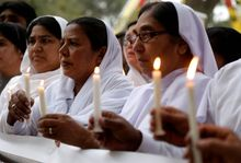 Pakistani nuns hold candles during a vigil for victims of Sunday's deadly suicide bombing in in Lahore, Pakistan. (Associated Press)
